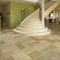 лестница в четверть оборота / металлическая конструкция / с каменными ступеньками / с подступенком